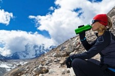 Woman Drinking In Mountains Xs 300x199